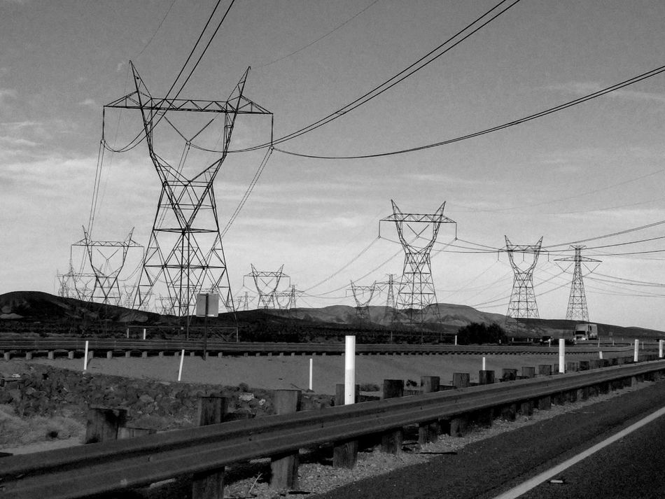 march of the pylons Electricity Pylon Electricity  Power Line  Outdoors Outdoors Photography EyeEm Gallery On The Road No People Electrical Lines Bnw Black And White Photography In A Car Eyem Gallery Going Home What I Saw Looking Out Of The Window Day