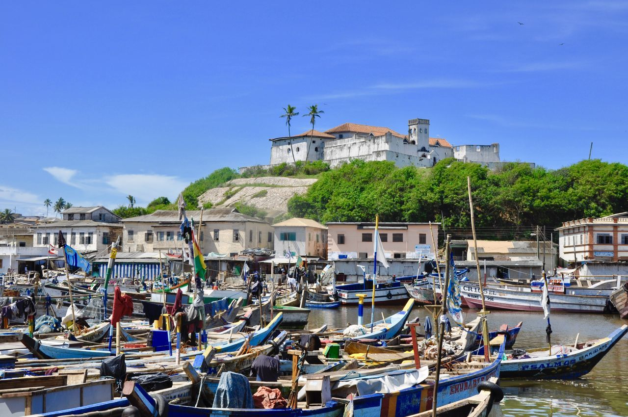 Architecture Building Exterior Castle Clear Sky Colonialism Elmina Elmina Castle Fishing Boat Fishing Village Ghana GoldCoast Harbor Historical Building Historical Monument Marina Moored Pirogue Slave Trade Tradition Traditional Traditional Culture Transportation Water Canoe Picturesque