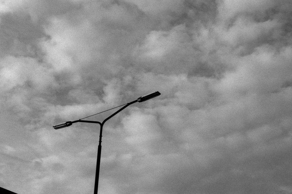 Street Lantern 35mm Film Analogue Photography Black & White City Clouds Contrast Fomapan100 Infrastructure Lantern Rodinal Silhouette Sky Street Symmetrical Symmetry Urban