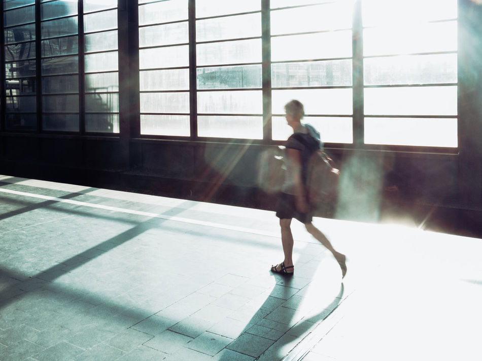 Walking in lensflares Berlin Summer 2016 One Man Only Adult Leisure Activity Window Indoors  Lensflares Sun Shiny Walking Wanderlust Sunlight POTD Picoftheday Photooftheday Railway Station Bahnhof Bahnhof Zoo The City Light