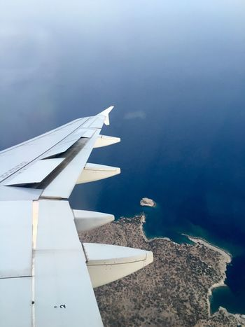 Airplane Mode Of Transport Flying Mykonos,Greece Greece Aircraft Wing Bestoftheday Besttime Lovely Weather Travel Aerial View Mid-air Sea Journey Blue Sky Nature Travelphotography Travel Vacations Summer Time  Returning Home Going The Distance Traveling Travel Photography