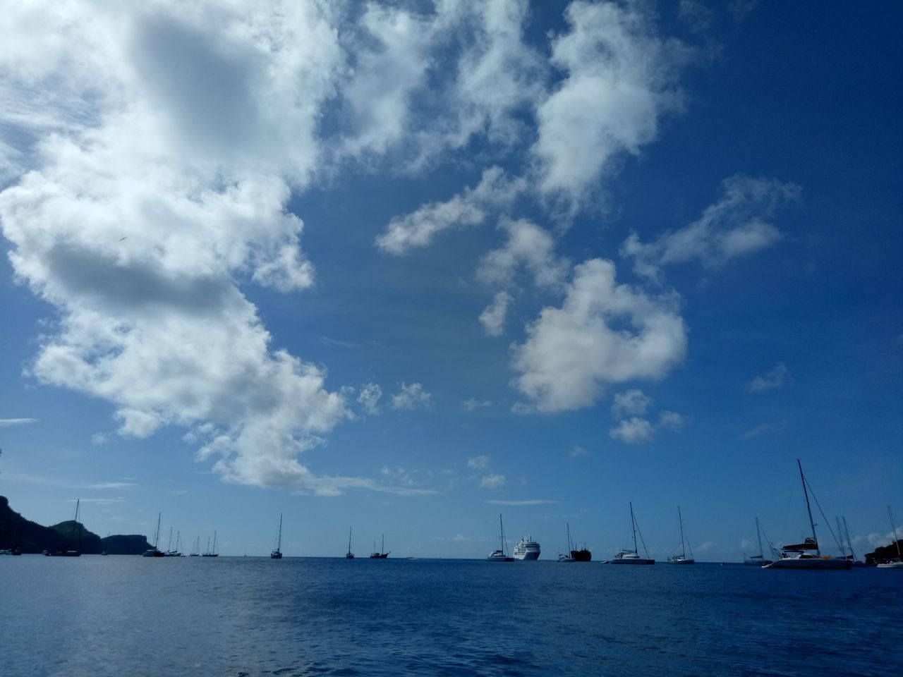 Blue Sea Cloud - Sky Nautical Vessel Water Outdoors Nature No People Sky Landscape Beach Beauty In Nature Sailboat Day Yacht travel destinations Island Resort Spa Scenics Beauty In Nature Relaxation