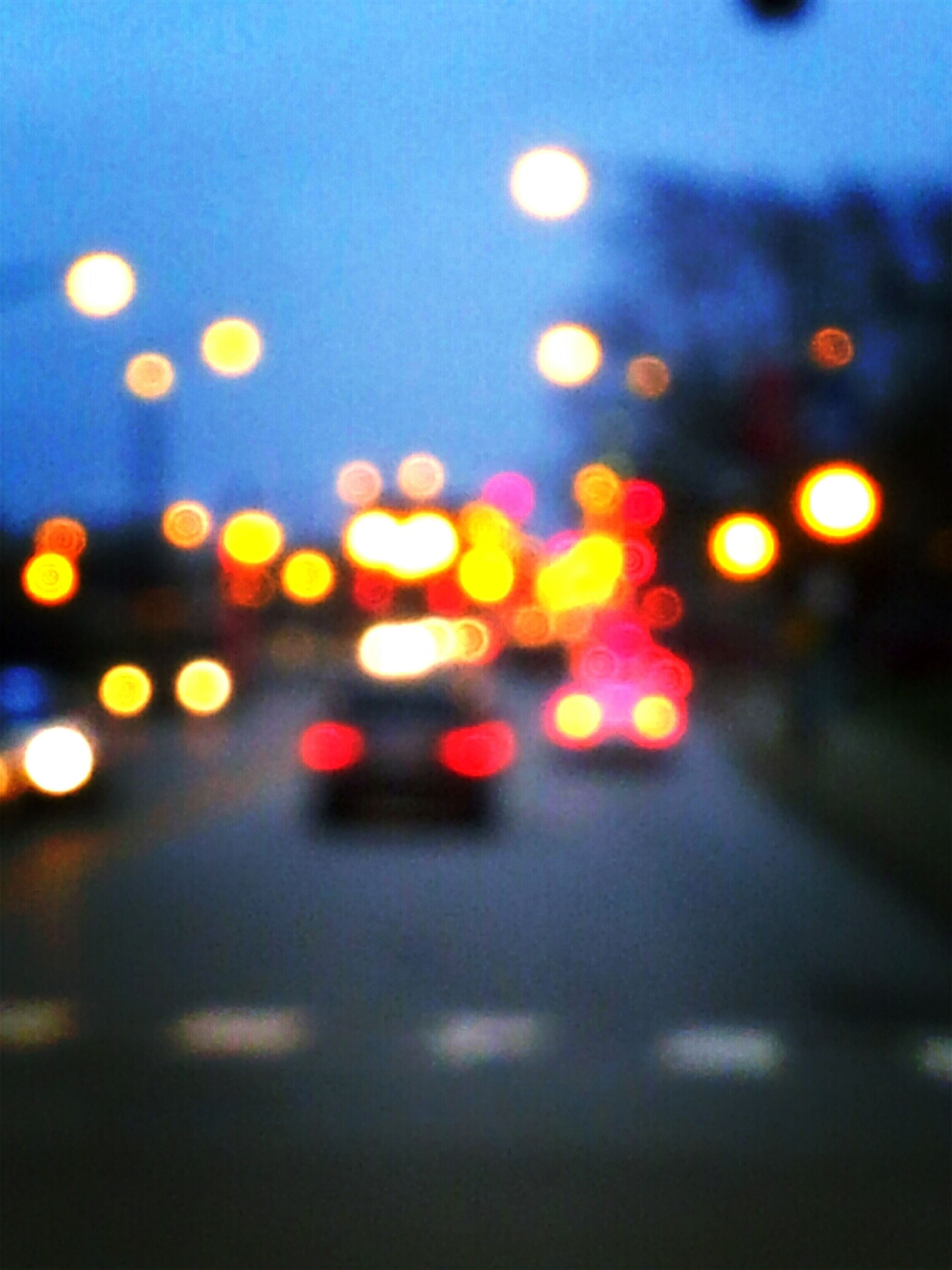 illuminated, night, defocused, transportation, multi colored, road, street, car, light - natural phenomenon, city, lens flare, blurred motion, no people, lighting equipment, glowing, motion, land vehicle, outdoors, circle, on the move