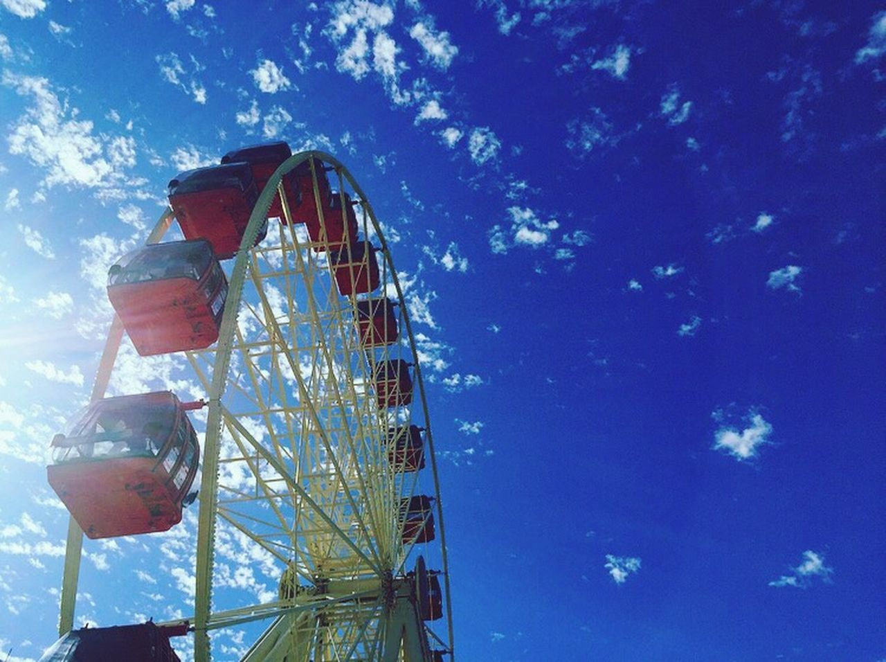 arts culture and entertainment, amusement park, low angle view, ferris wheel, sky, blue, no people, amusement park ride, outdoors, day, tree