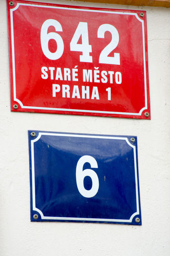 Traditional street number sign in city Central European  Prague Red Blue Close-up Communication Metal No People Stare Mesto Street Sign Street Signage Traditional