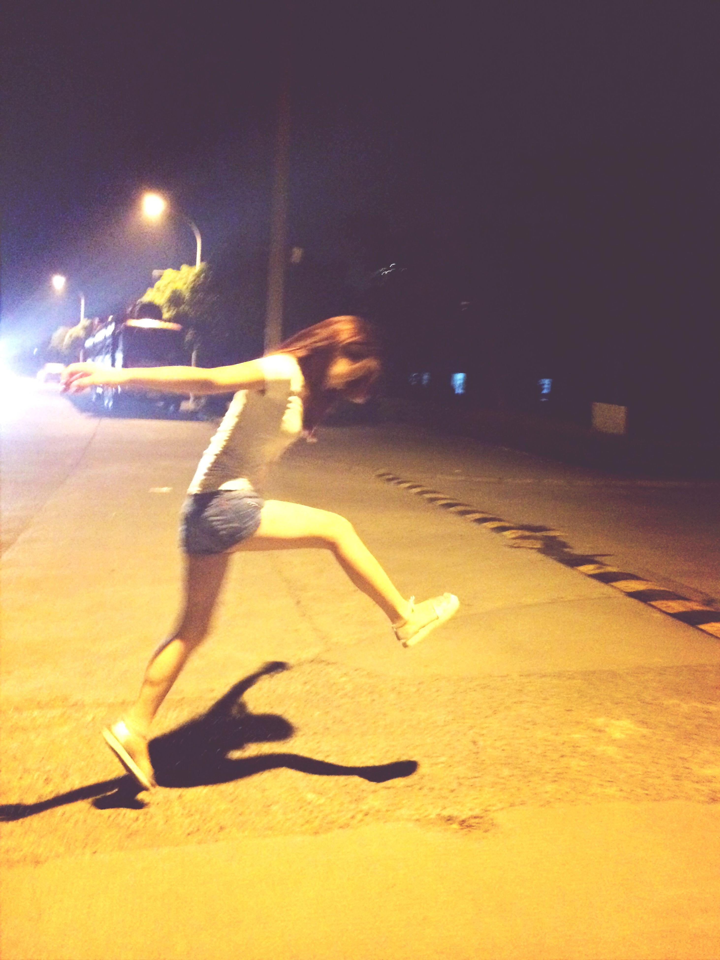 night, full length, transportation, lifestyles, street, bicycle, mode of transport, shadow, leisure activity, road, land vehicle, street light, men, walking, sunlight, illuminated, on the move, motion