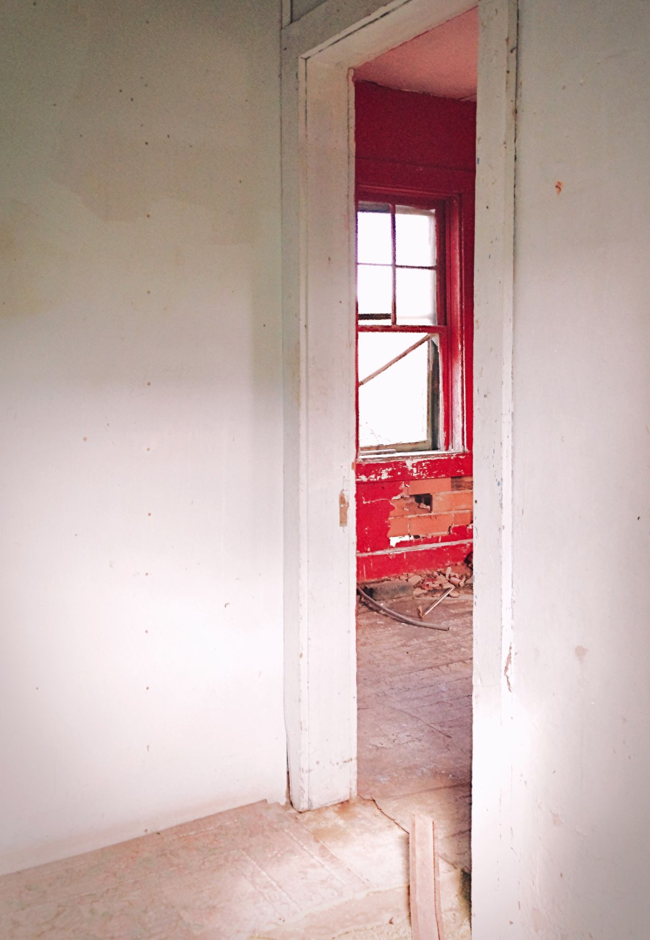 """""""The Red Room"""" Shot through a broken door into the interior of an abandoned house in the ghost town of Ancho, New Mexico. Ancho, was a former railroad and ranching community. The settlement was established at the turn of the 20th century when families began to settle the fertile valley, followed by a number of homesteaders who became the area's first sheep and cattle ranchers. Miners also roamed the area of gypsum hills in search precious metals. Window Abandoned Indoors  Damaged No People Architecture Ghost Town Abandoned Buildings Abandoned Places New Mexico Newmexicophotography Doorway Interior Red Red Color Old Buildings"""