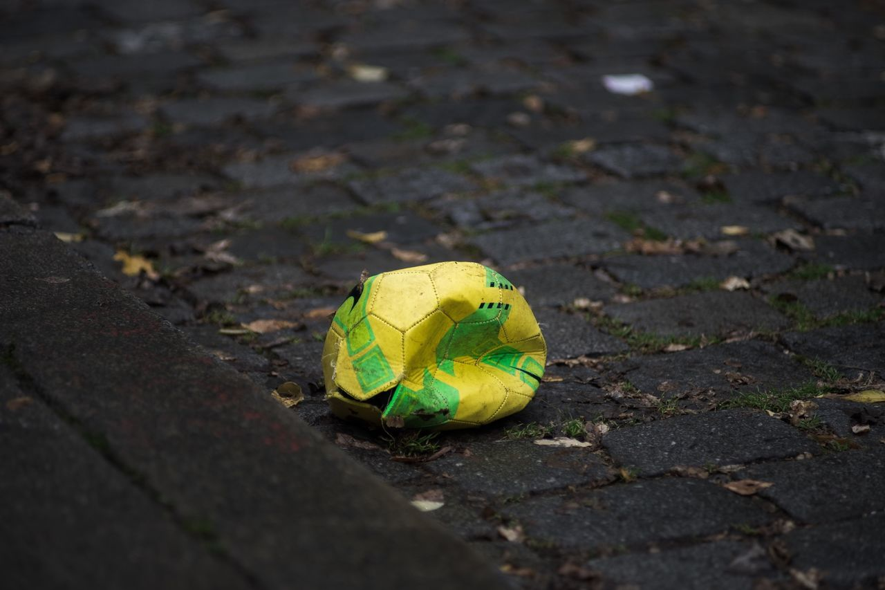 Beautiful stock photos of soccer balls, Close-Up, Cobblestone, Damaged, Day