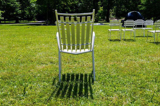 Take a seat Absence Beauty In Nature Chair Day Empty Eye4photography  Grass Grassy Green Color Lawn Nature No People Outdoors Park Park - Man Made Space Relaxation Seat Shadows Sunlight TheWeekOnEyeEM Tranquil Scene Tranquility