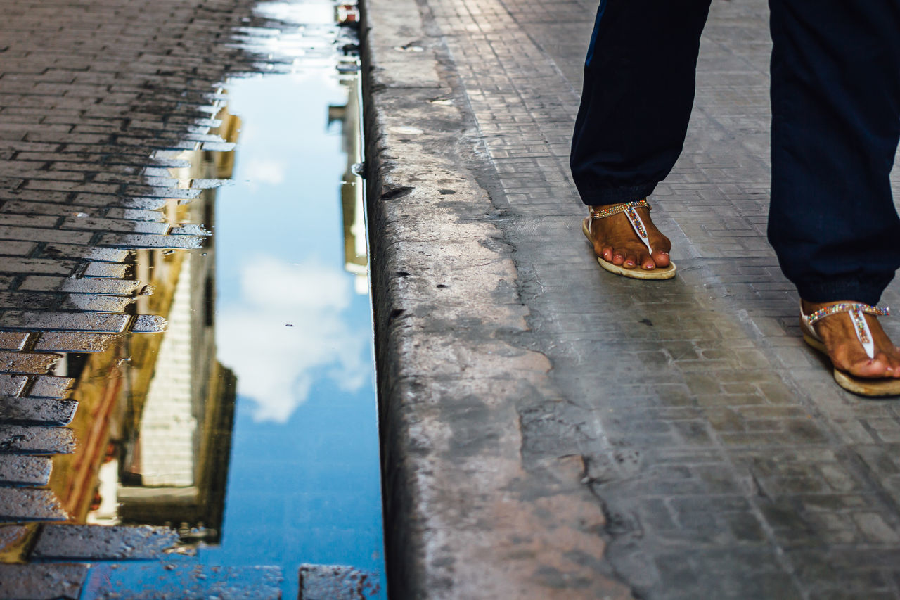 Alone Art Is Everywhere Break The Mold City City Life Cuba Collection Cuban Cuban Life Getting Inspired Human Body Part Human Leg Low Section Old Havana One Person Outdoors Pool Real People Reflection Shoe Sky Standing Streetphotography Walking Water