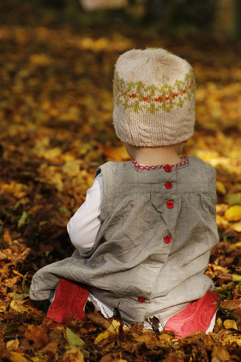 Autumn Autumn Leaves Backside Portrait Child Focus On Foreground Knit Hat Outdoors Young Child