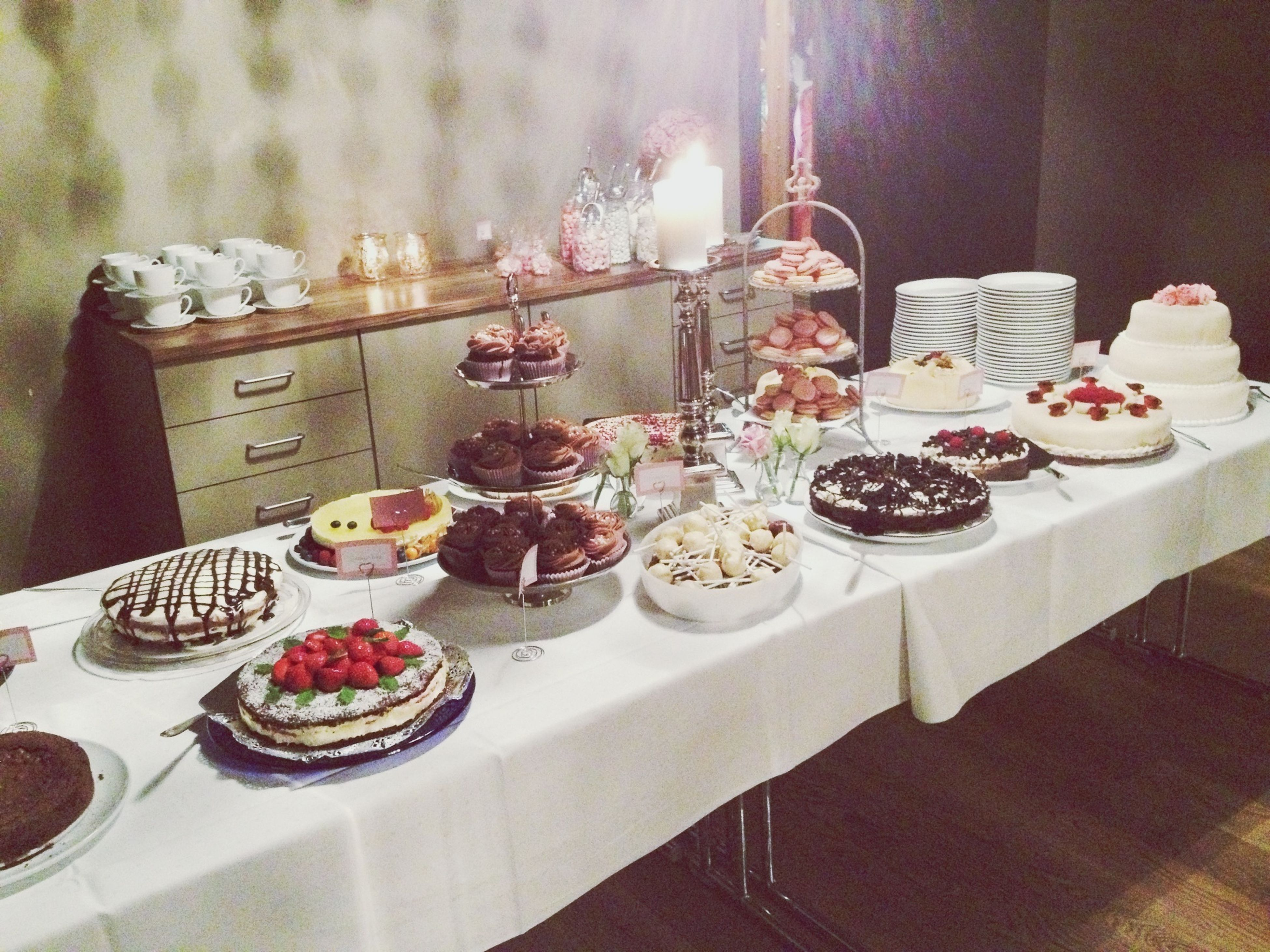 indoors, food and drink, table, freshness, food, still life, sweet food, plate, ready-to-eat, variation, indulgence, dessert, glass - material, arrangement, cake, drinking glass, unhealthy eating, close-up, no people, restaurant