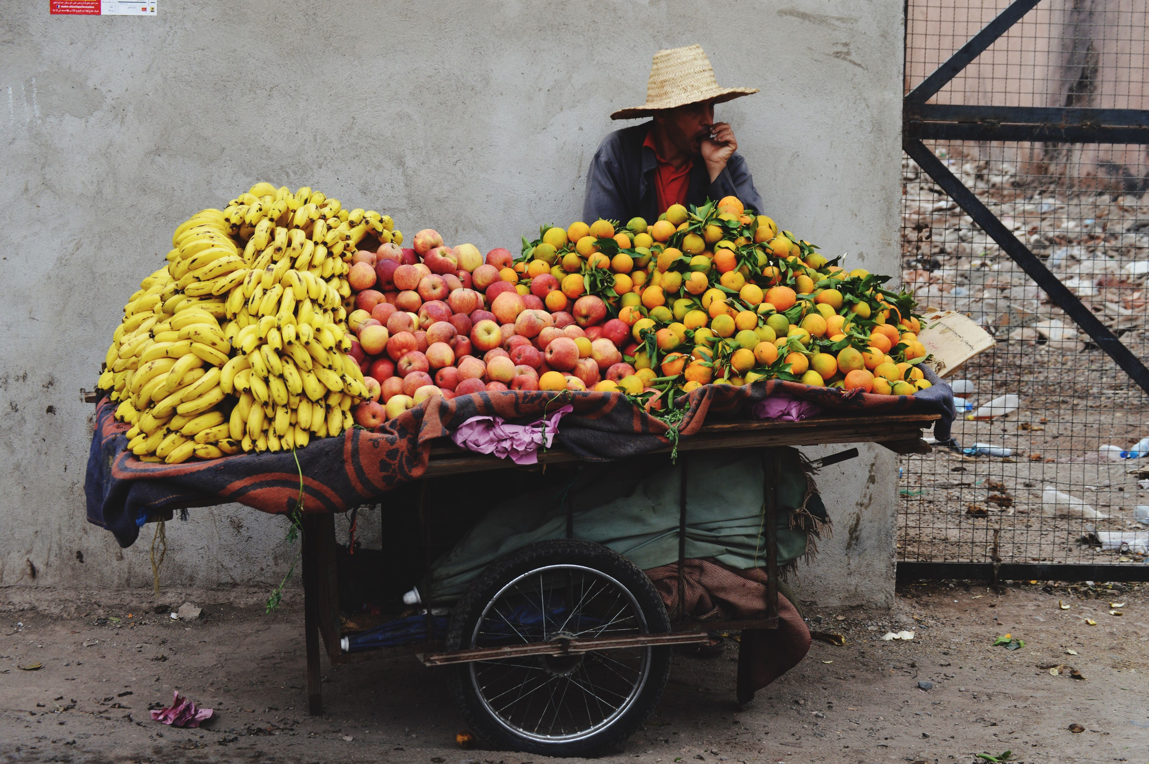 fruit, real people, transportation, one person, food, outdoors, mode of transport, bicycle, freshness, day, bicycle basket, cart, adults only, adult, people