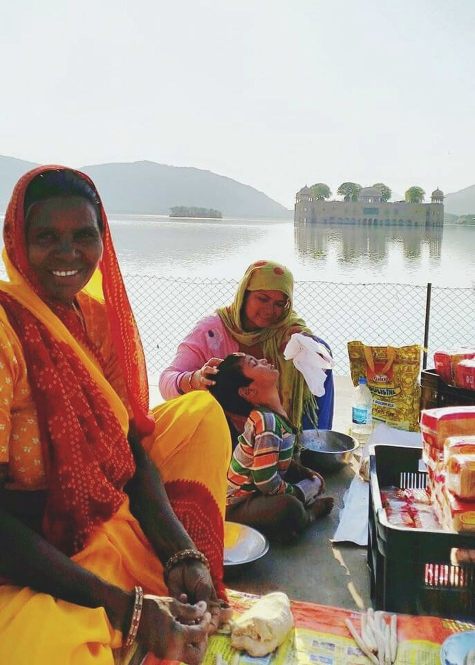 The simple life - A food vendor and her family all smiles at the site of the first customer. Incredible India Jaipur Lakepalace Jalmahal Pinkcity Jaipur Mother And Son Love Happiness Eyem Best Shots EyeEmbestshots EyeEm Gallery Hometown Home