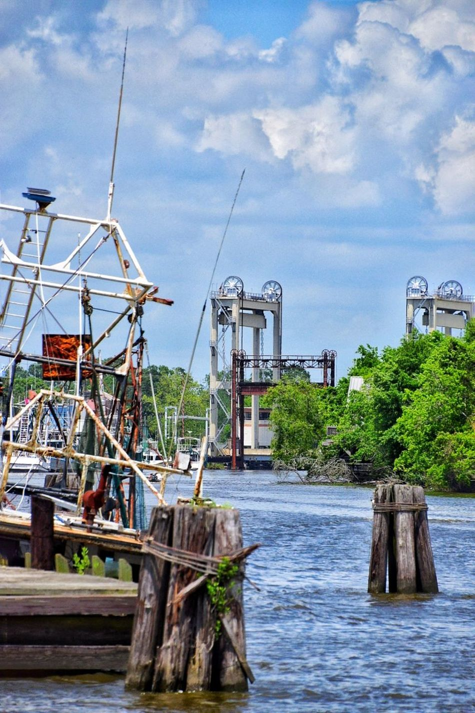 Water Outdoors Nautical Vessel Cloud - Sky Pier Built Structure No People Bayou Drawbridge  Harbor Travel Destinations Vacations Tourism Sky Sea Tranquility Beach Day Stilt House Architecture Boats Trees