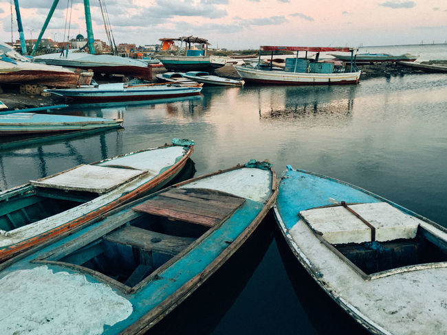 Egypt Poor  Transportation Wooden Boat Boat Boats Egyptian Fishing Fishing Boat Lake Moored Nature Nautical Vessel No People Outdoors Refliction Sunset Transportation Village Village Life Water Wooden