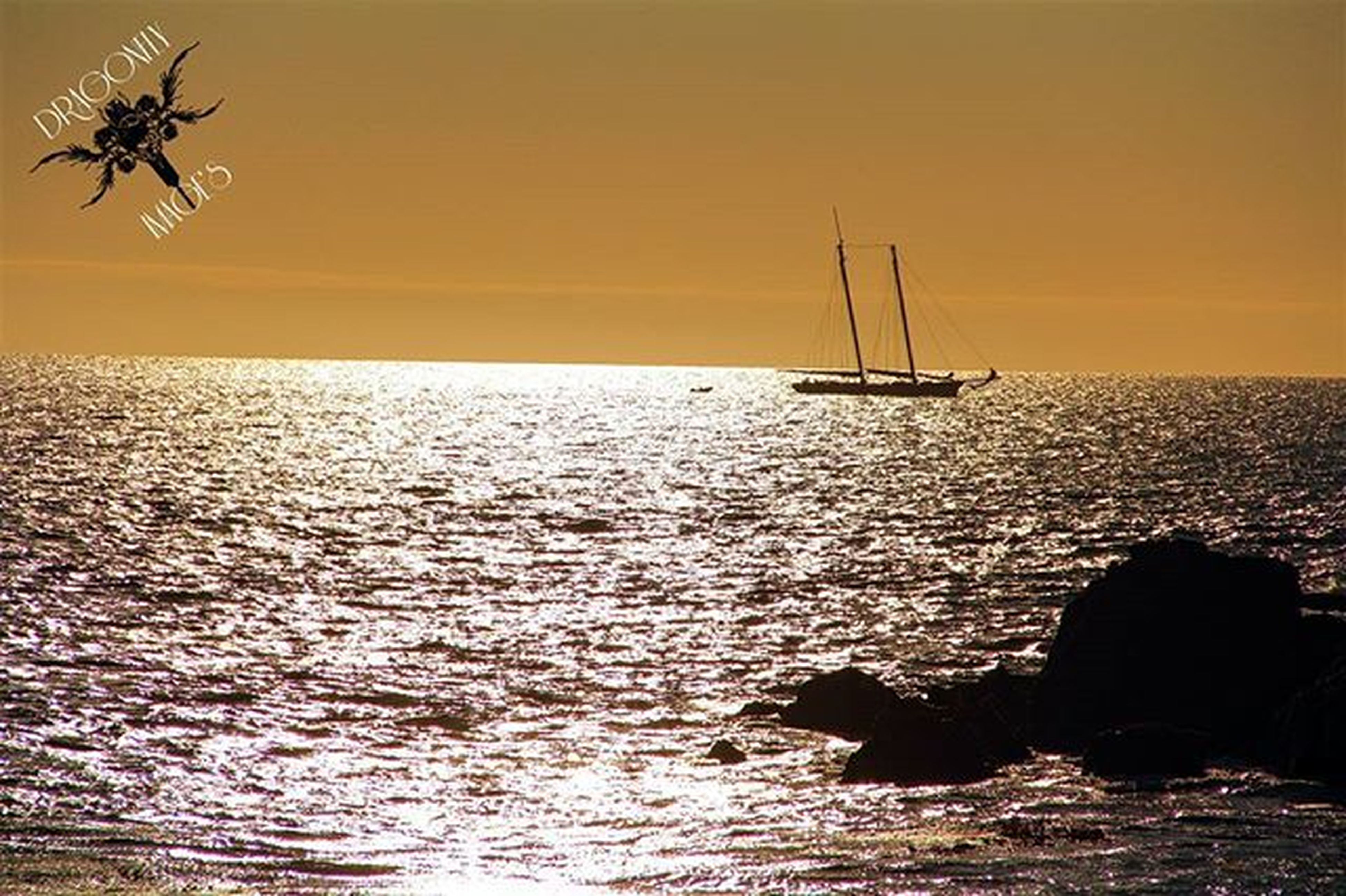 sea, water, horizon over water, sunset, nautical vessel, transportation, boat, mode of transport, silhouette, scenics, beauty in nature, sky, waterfront, tranquil scene, tranquility, nature, orange color, idyllic, rippled, sailing
