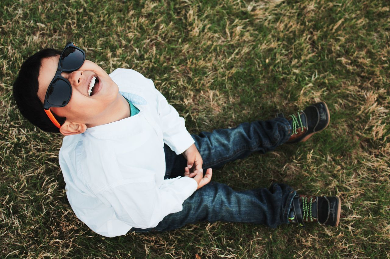 Casual Clothing Day Field Full Length Grass Happy Kiddo :)  Happy Self Kid Leisure Activity Lifestyles Looking At Camera Person Portrait Relaxation Sitting Smiling Standing Sunglasses Three Quarter Length Young Adult Young Men