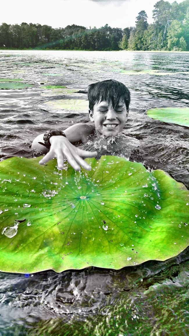 My son was blown away that the lily pads were bigger than his upper body Swimming Enjoying The Sun EyeEm Nature Lover Martin Lake State Park Check This Out Splashing Lillypads Eyem Best Shots