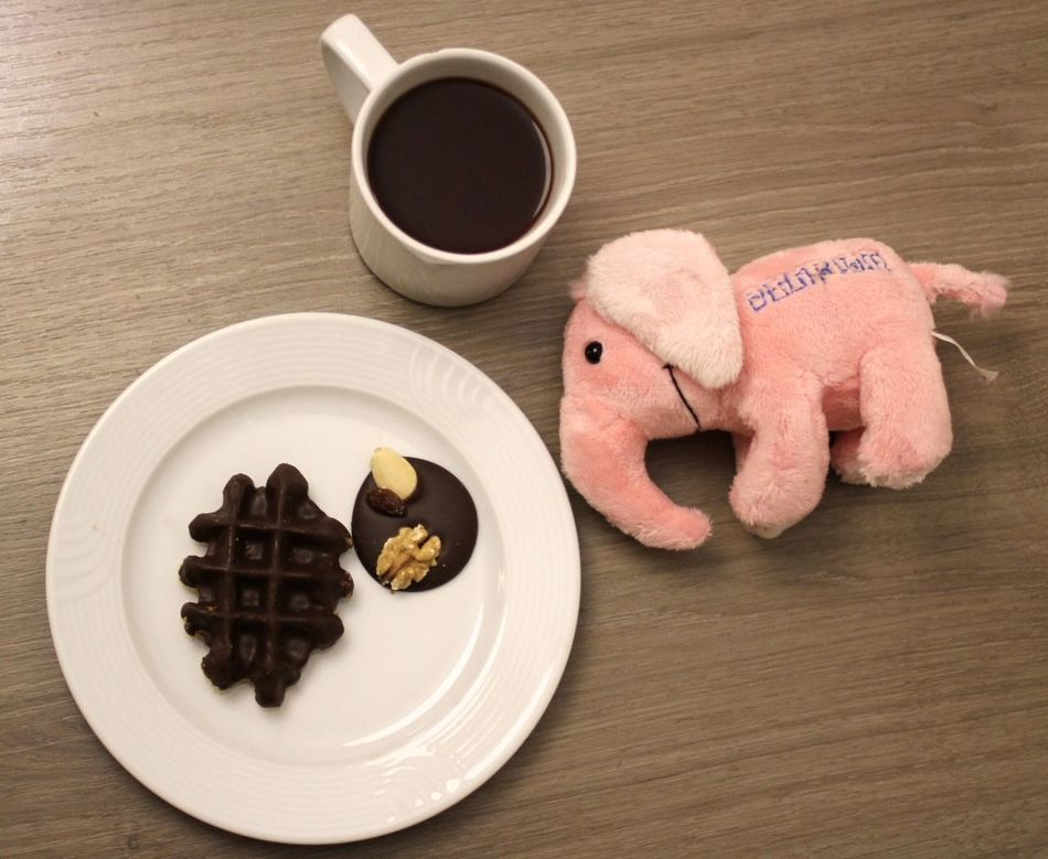 Waffle, chocolate, hot chocolate and the pink plush elephant from Delirium Beer on a wooden table Chocolate Coffee Delirium Tremens Deliriumcafe Food Food And Drink Indoors  No People Pink Elephant Plush Sweet Food Table Waffle Wooden Table