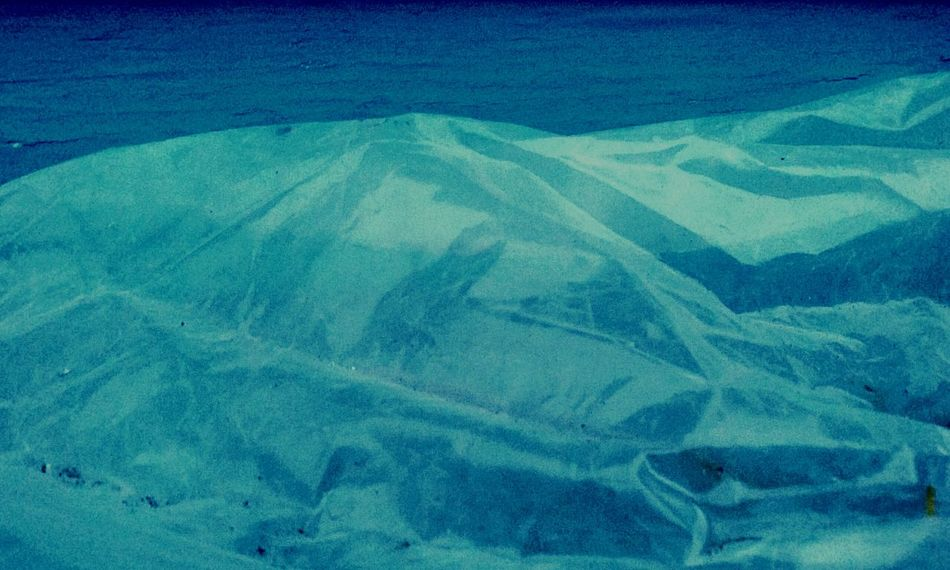 This Visqueen appears to be a Mountainous Tranquil Scene . Sometimes Scenics such as a Mountain can be Expressed through other Objects found in Nature. The Beauty In Nature such as this Blue Aerial View of a Non-urban Scene take us on Vacations Outdoors even if thePhysical Geography is just a Majestic mound of Plastic and not someplace Remote .