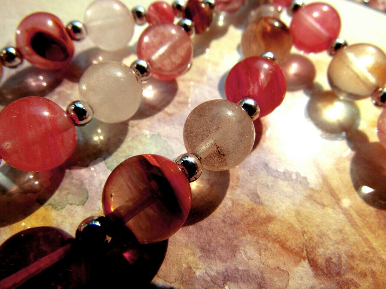 Close-Up Of Bead Necklace On Table