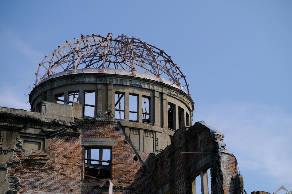 Arch Architectural Feature Architecture Atomic Bomb Dome Blue Building Building Exterior Built Structure Cloud Cloud - Sky Exterior Façade High Section Hiroshima Historic Japan Low Angle View No People Old Outdoors World Helitage