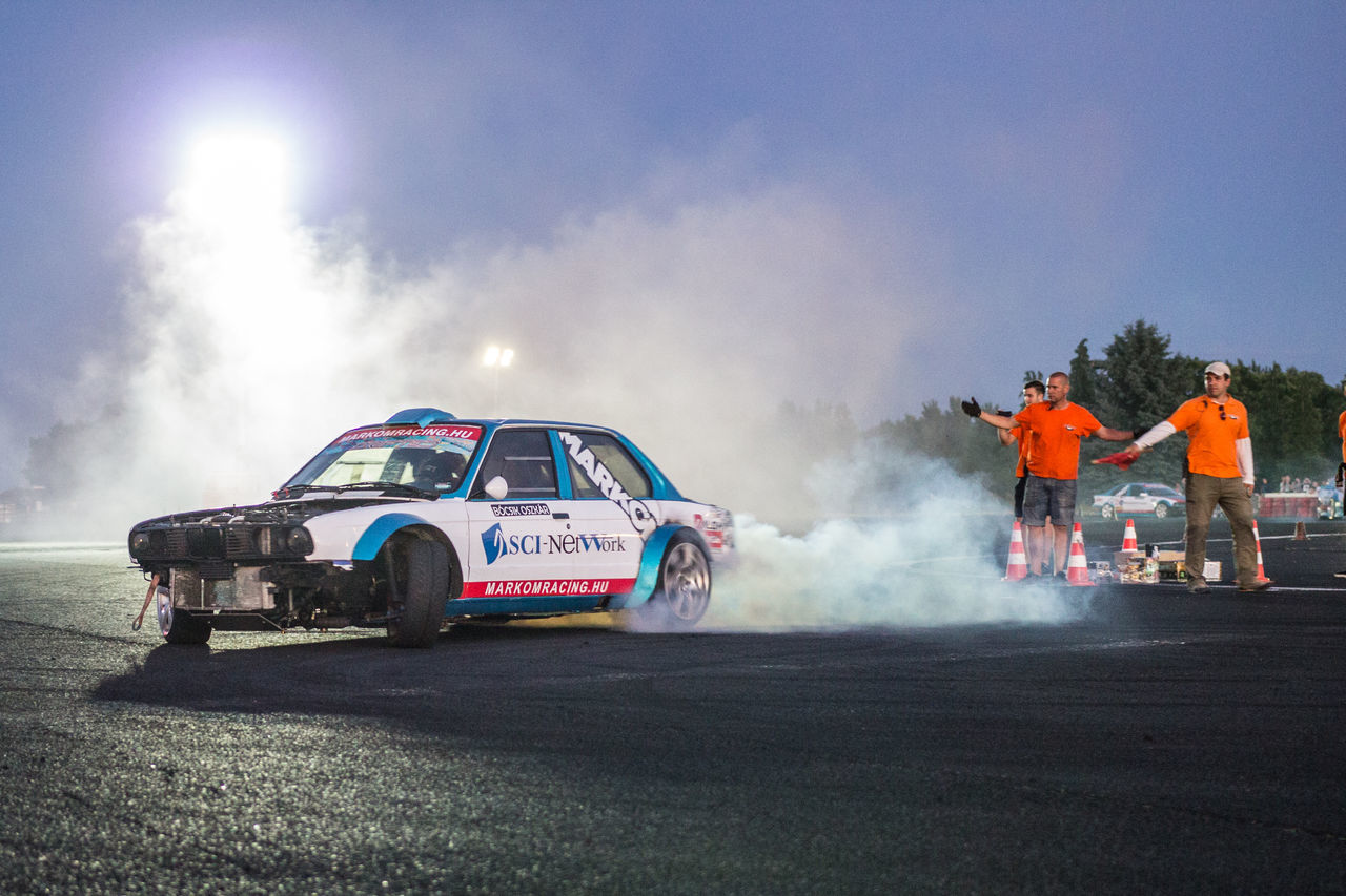 Auto Racing Competition Drift Driftcar Drifting Extreme Sports Extremesport Horsepower Land Vehicle Markomracing Men Moon Moonlight Motorsport Night Nightphotography Outdoors People Race Racecar Real People Smoke Smoke - Physical Structure Sports Race Sports Track