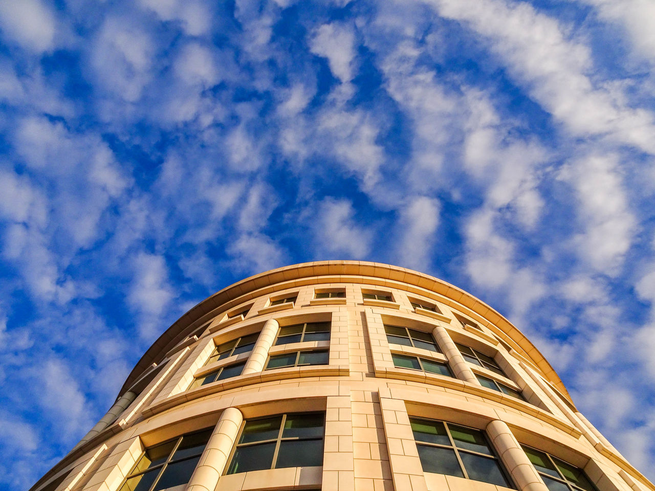 Clean building against blue sky background. Architecture Architecture Backgrounds Building Exterior Building Exteriors Built Structure City Life Clean Lines Cloud - Sky Day Dc Focused Futuristic Getty Images Look Up And Thrive Low Angle View No People Outdoors Sky Skyscraper Travel Destinations