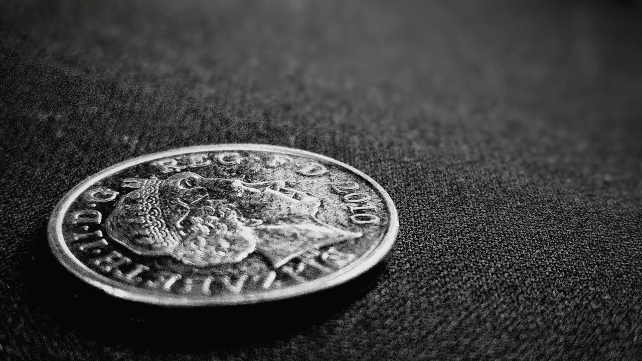 Close-Up Of Coin On Fabric