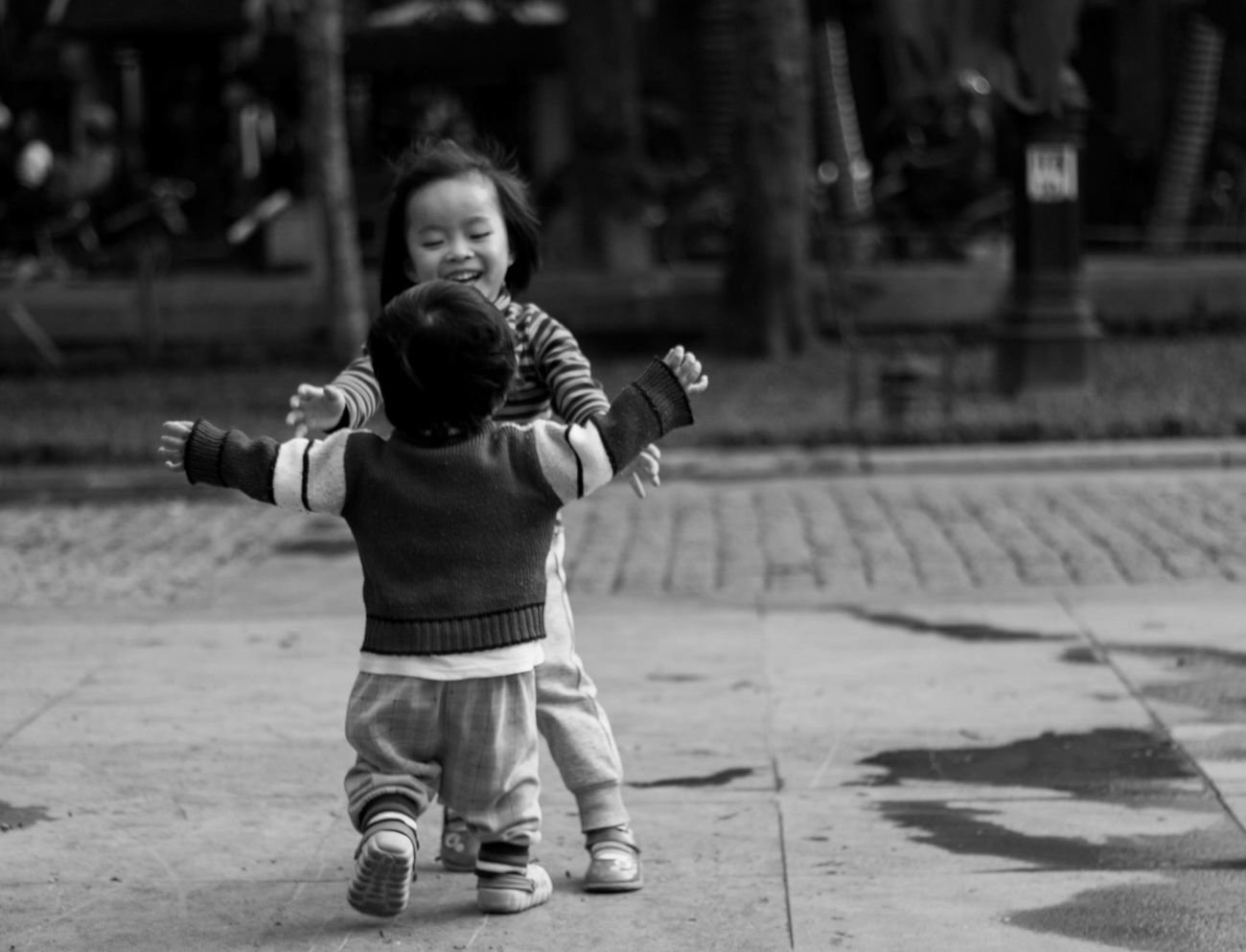 The Human Condition Children Hug Asian  Traveling Streetphotography City