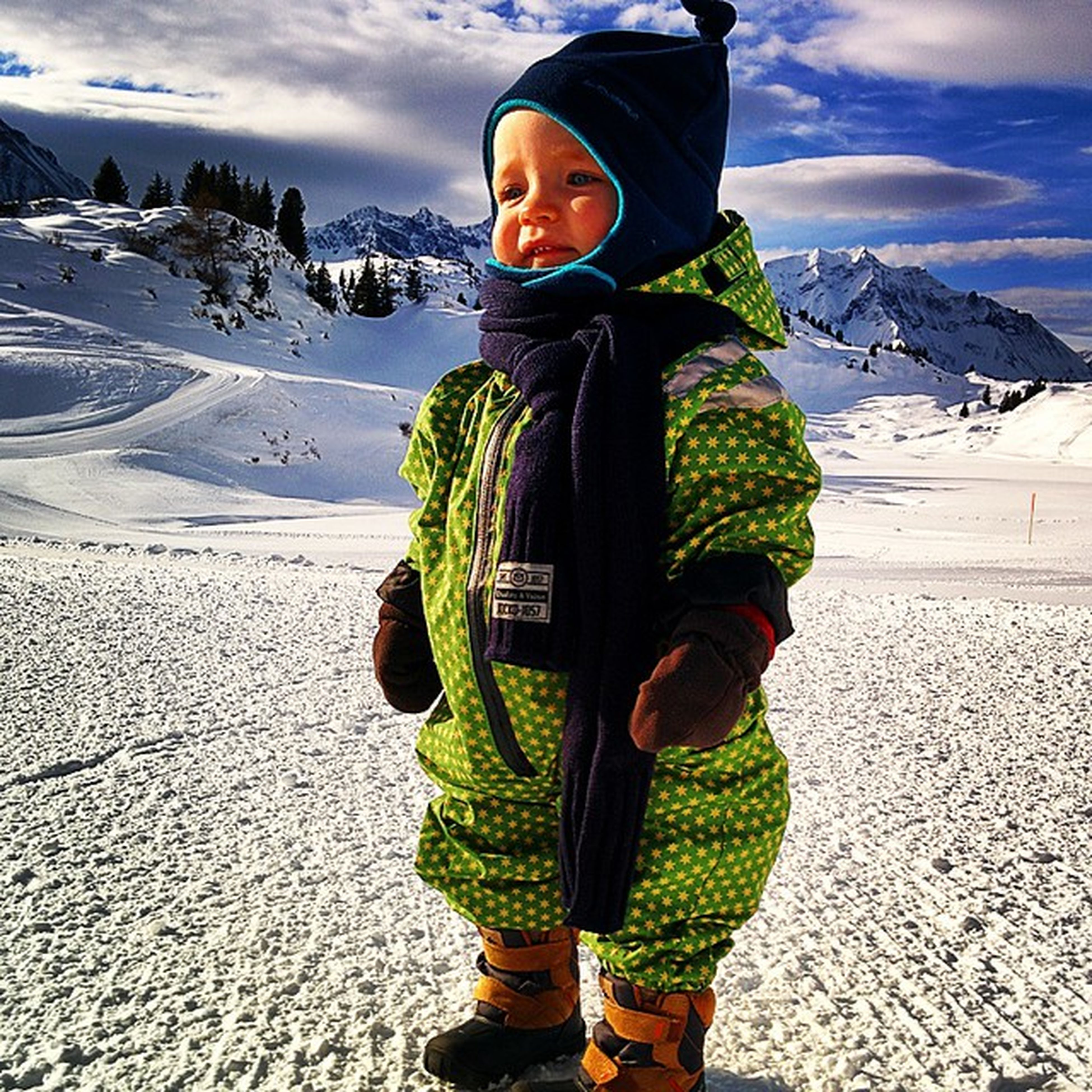winter, snow, cold temperature, lifestyles, warm clothing, standing, leisure activity, sky, casual clothing, season, mountain, full length, front view, weather, looking at camera, portrait, hooded shirt, person