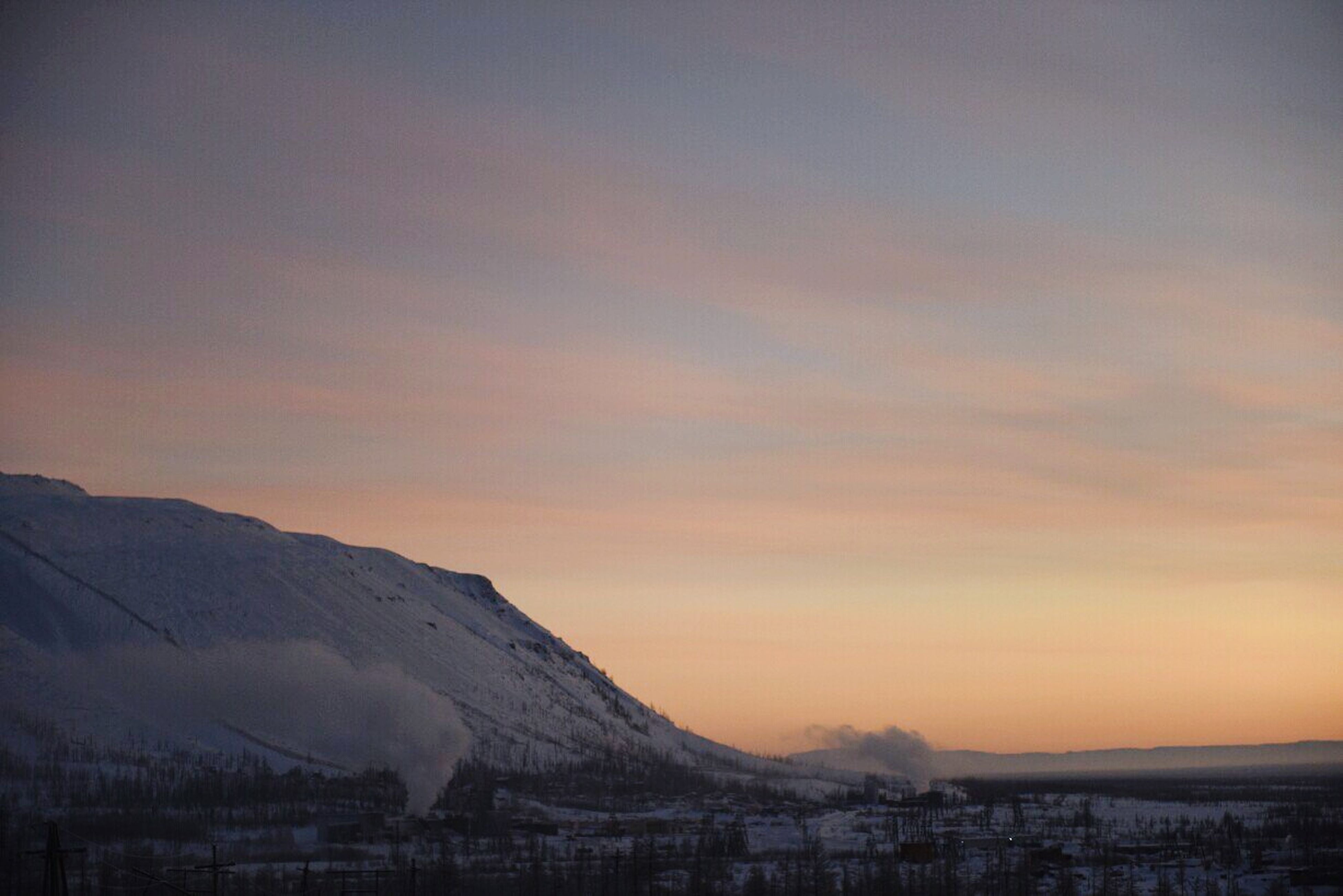 winter, snow, mountain, cold temperature, sunset, scenics, tranquil scene, mountain range, beauty in nature, season, tranquility, sky, landscape, weather, orange color, nature, covering, snowcapped mountain, cloud - sky, idyllic
