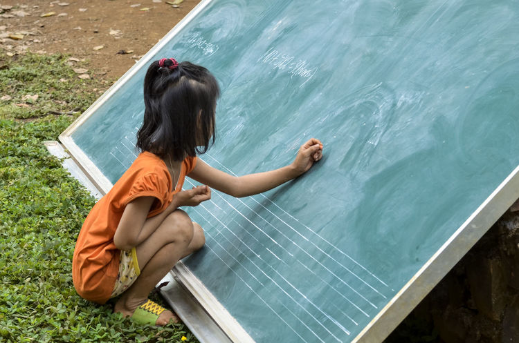 Study math Board Chalkboard Day Ethnic Minorities Mathematics One Person Outdoors Piece Of Chalk Sitting Study Write Write With Colors