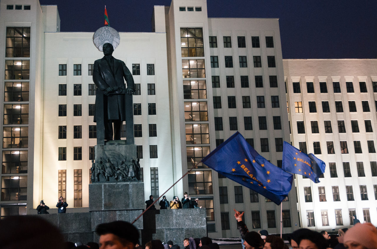 Minsk, Belarus - February 17, 2017 - Belarusian people participate in the protest against the decree 3 'On prevention of social parasitism' of President Lukashenko in the center of Minsk. Protesters pass by the monument to Lenin. Adult Adults Only Architecture Architecture Belarus Building Exterior Built Structure City Façade Flag Large Group Of People Lenin Monument Outdoors People Politics Protest Protesters Real People Square
