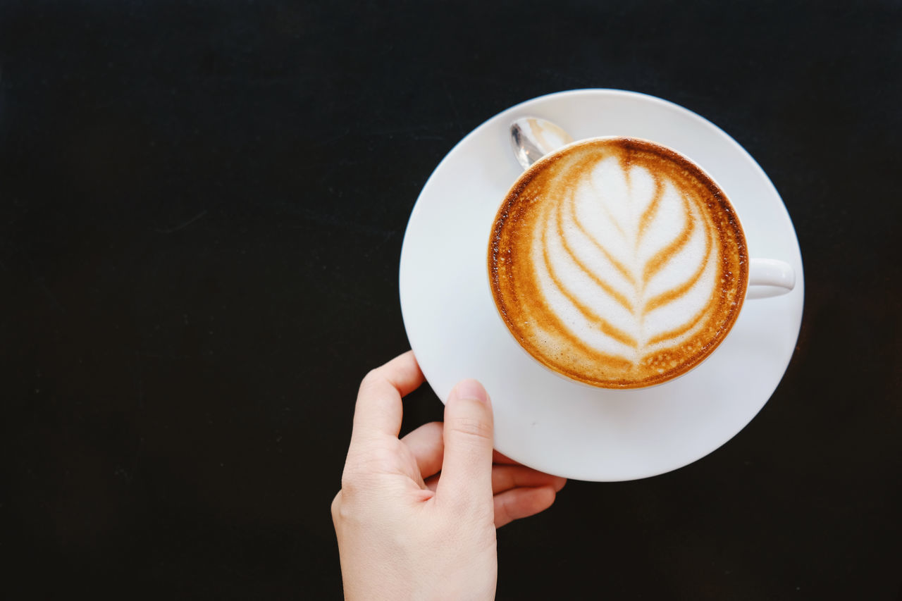 Black Background Cappuccino Cappucino Close-up Coffee - Drink Coffee Cup Copy Space Day Drink Food And Drink Freshness Froth Art Frothy Drink Holding Human Body Part Human Hand Indoors  Latte Lifestyles One Person People Refreshment Saucer Top View Women