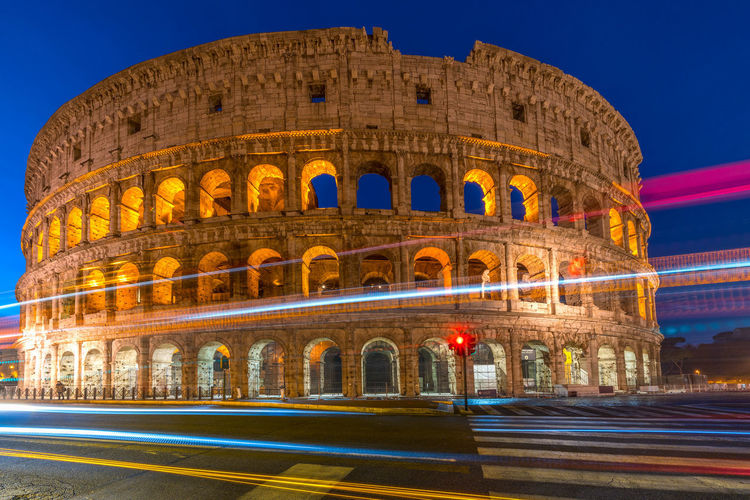 The Great Coliseum in Rome, Italy Coliseum Colosseo Pantheon Roma St. Peter's Basilica Trevi Fountain Vatican Ancient Arch Architecture Building Exterior Built Structure City Clear Sky History Illuminated Italy Light Trail Long Exposure Motion Night No People Old Ruin Outdoors San Pietro Sant'angelo Sky Tiber Tourism Travel Travel Destinations