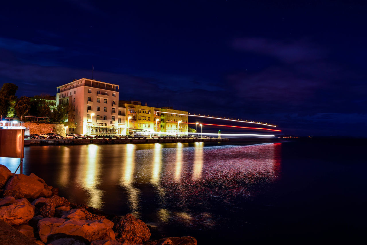 Architecture Boat City Cityscape Cloud - Sky Dusk Igniting Illuminated Long Exposure Long Exposure Night Photography Long Exposure Shot Mystery Neon Night No People Outdoors Reflection River Ship Sky Travel Destinations Water Waterfront