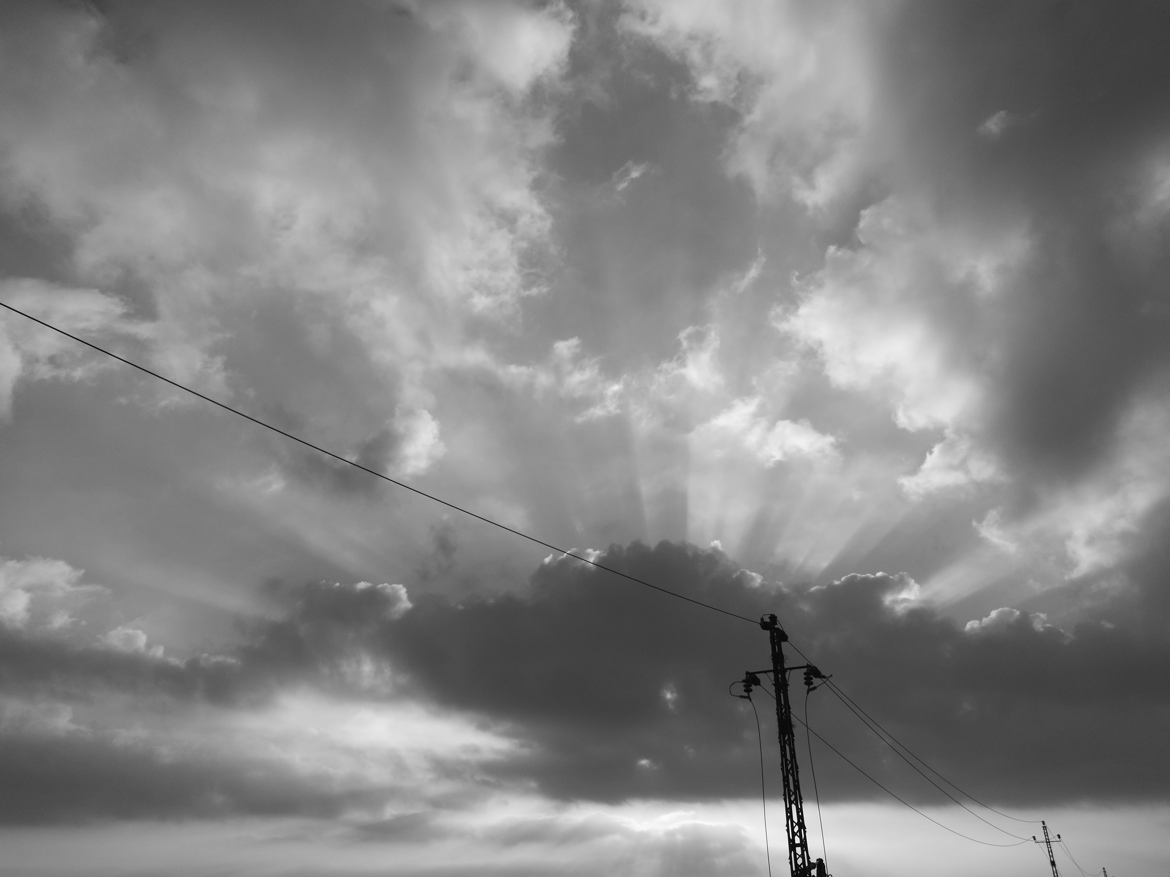 low angle view, sky, cable, cloud, connection, technology, power line, crane - construction machinery, day, cloud - sky, high section, development, power supply, nature, outdoors, tall, scenics, progress, tranquility, telephone line, cloudy, antenna, no people, cloudscape, telephone pole, long