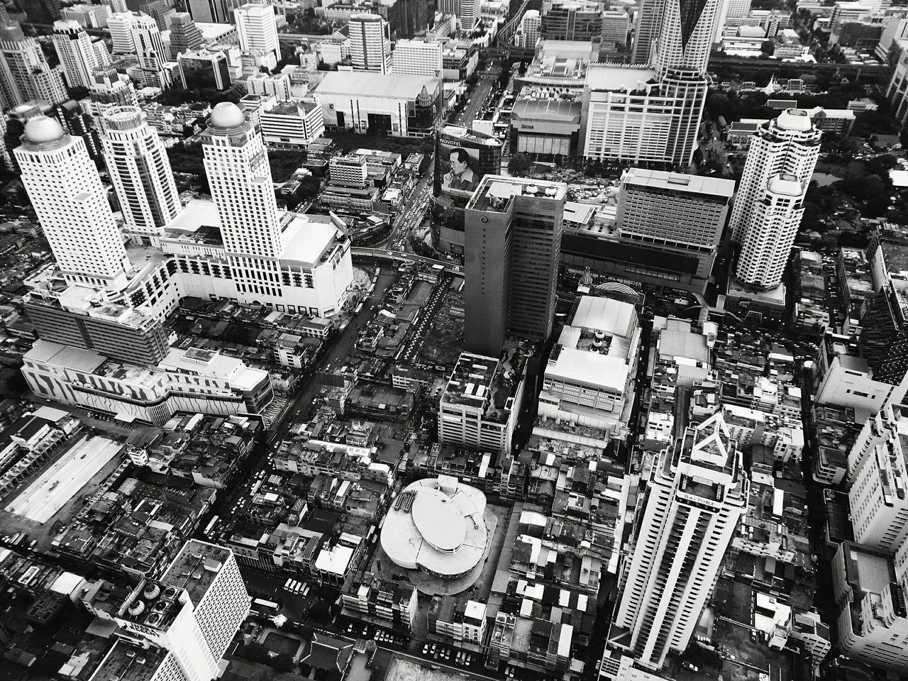 city, skyscraper, cityscape, building exterior, architecture, crowded, modern, high angle view, aerial view, built structure, travel destinations, outdoors, urban skyline, day, people