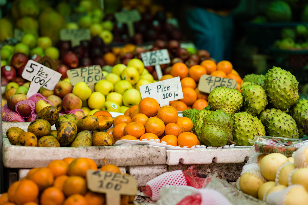 Fruit stall at a local market in Kandy, Sri Lanka Business Cucumber Ella Farmer's Market Food Food And Drink Freshness Fruit Fruits Healthy Eating Juicy Kandy Local Food Local Market Market Market Market Stall Marketplace Multi Colored Price Tag Sri Lanka Sri Lankan Tourism Variation Vegetable