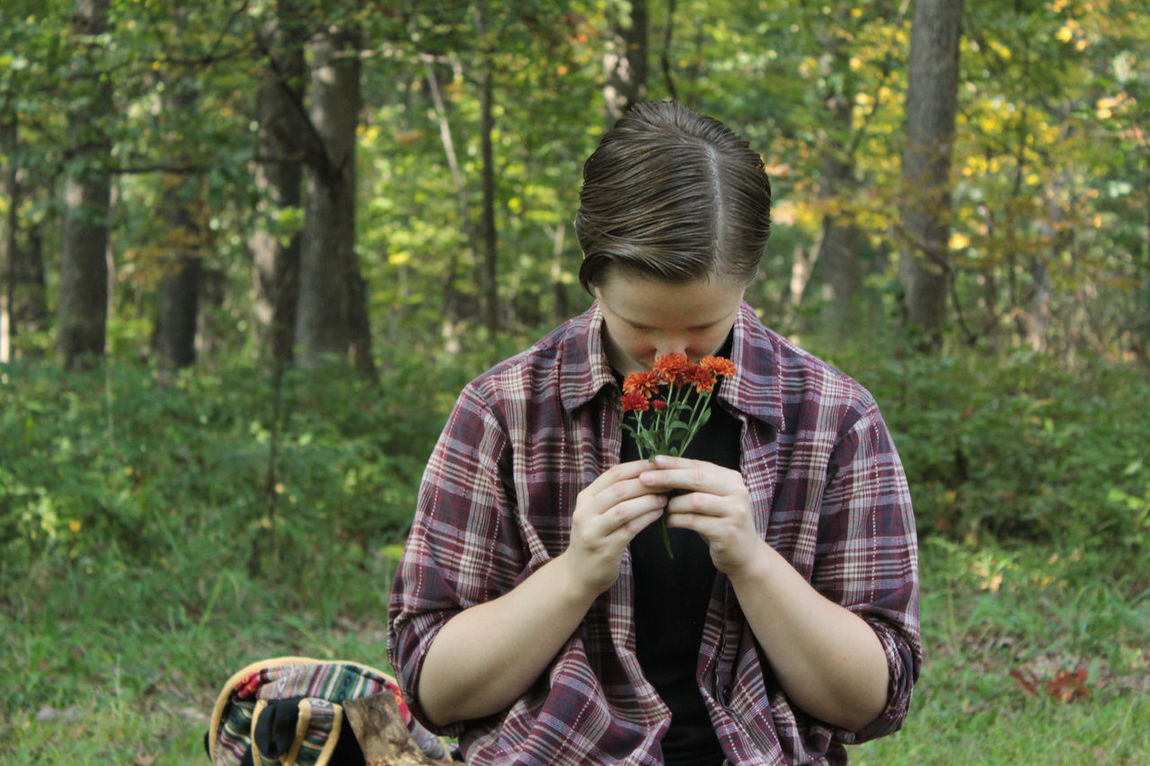 Calming Casual Clothing Day Leisure Activity Lifestyles Nature Outdoors Peace Portrait Smelling Flowers Smelling The Flowers Smelling The Roses Tranquility Tree