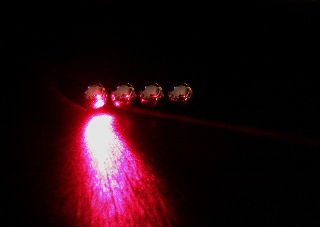 Red Laser Light In Dark
