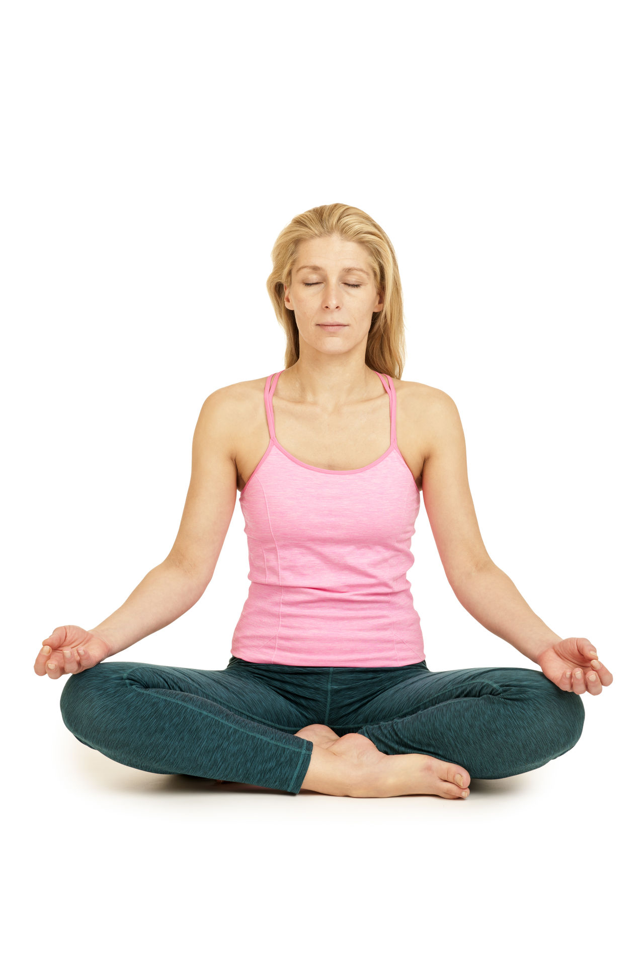 Frontal full-body view of a young woman in front of white background in the Lotus position (Padmasana). Adult Beautiful Woman Beauty Blond Hair Body Care Cross-legged Eyes Closed  Females Full Length Healthy Lifestyle Leisure Activity Lifestyles Lotus Position Meditating Padmasana Relaxation Religion Sitting Smiling Studio Shot Wellbeing Women Yoga Young Adult Zen-like