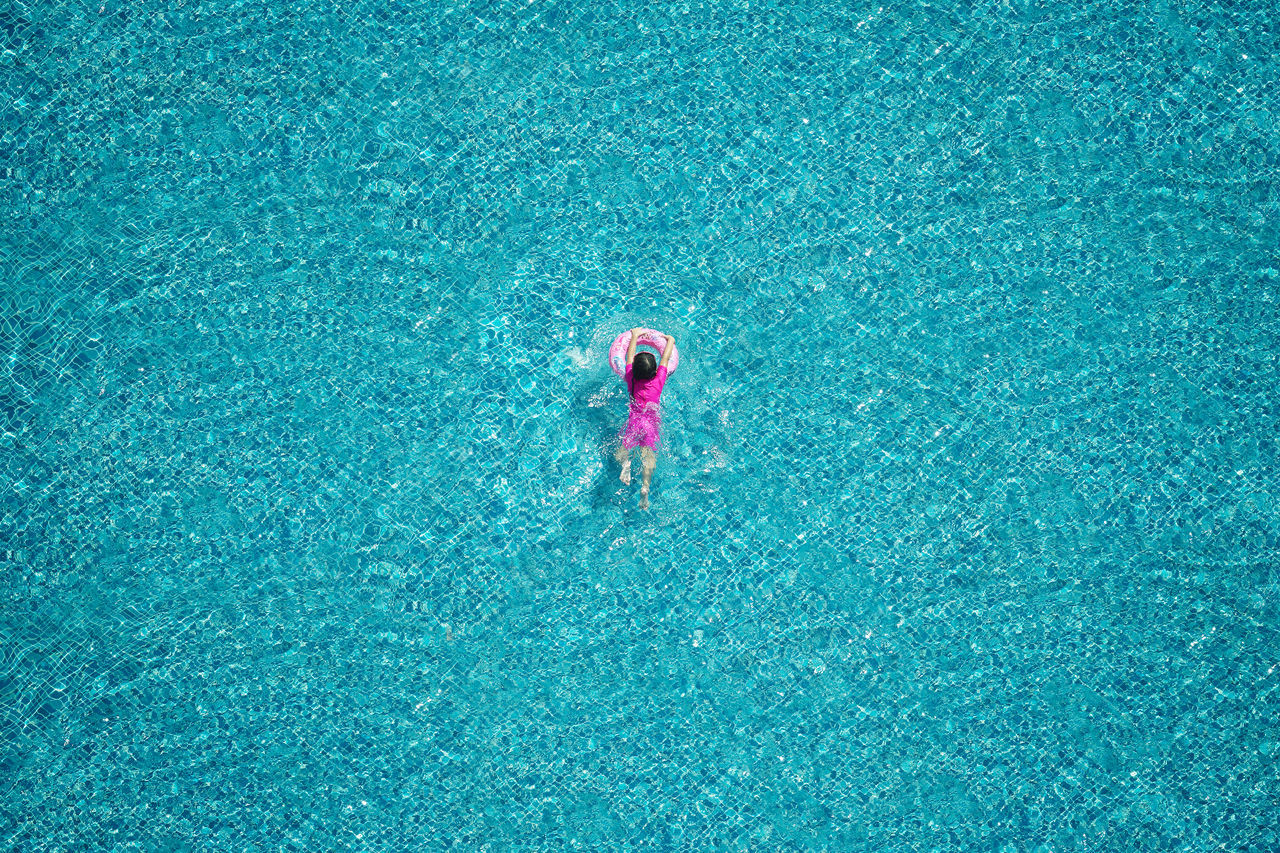 Top view of girl swimming in the pool. Childhood Day Full Length Happiness High Angle View Kid Minimalism One Person Outdoors People Real People Sport Swim Swimming Pool Fresh On Market 2017