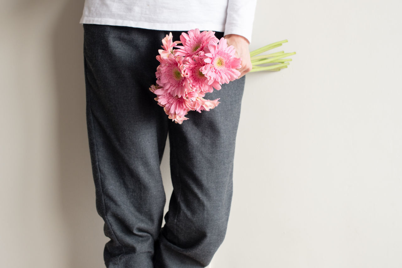 Woman holding pink gerbera daisies (cropped) Adult Adults Only Close-up Day Flower Fragility Freshness Human Body Part Human Hand Indoors  Low Section Midsection One Man Only One Person People Pink Color Real People Standing Woman