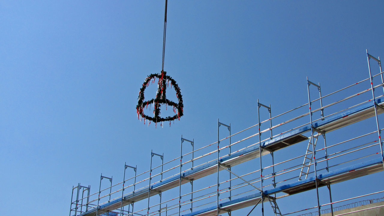 Roofing Ceremony Topping-out Ceremony Construction Site Scaffolding Building Industry Ceremony Clear Sky Construction Industry Day Low Angle View No People Outdoors Roofing Scaffoldings Sky