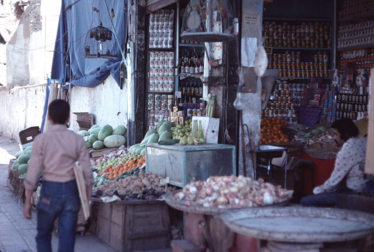 Rescued vintage colored slide from 1977 of a street market scene. Does have scratches and crazing from the slide. Egypt Egyptian Market Food For Sale Market Market Stall Outdoor Market Outdoors Rear View Small Business Working