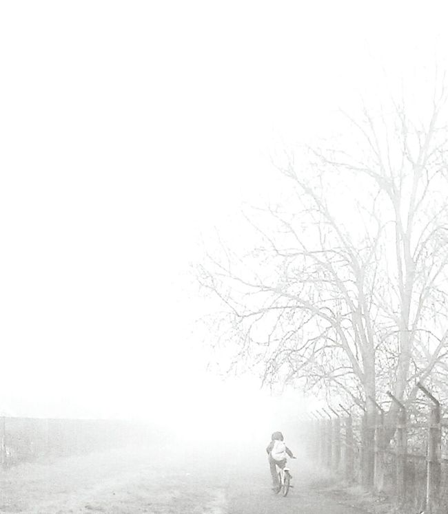 Real People Outside Cycling Misty Morning Little Boy Head In The Clouds 😜 Beauty In Nature Selective Focus Leisure Activity Confidence  Full Length One Child Black And White Photography Close To Nature Innocence Nature Photography Carefree Nature