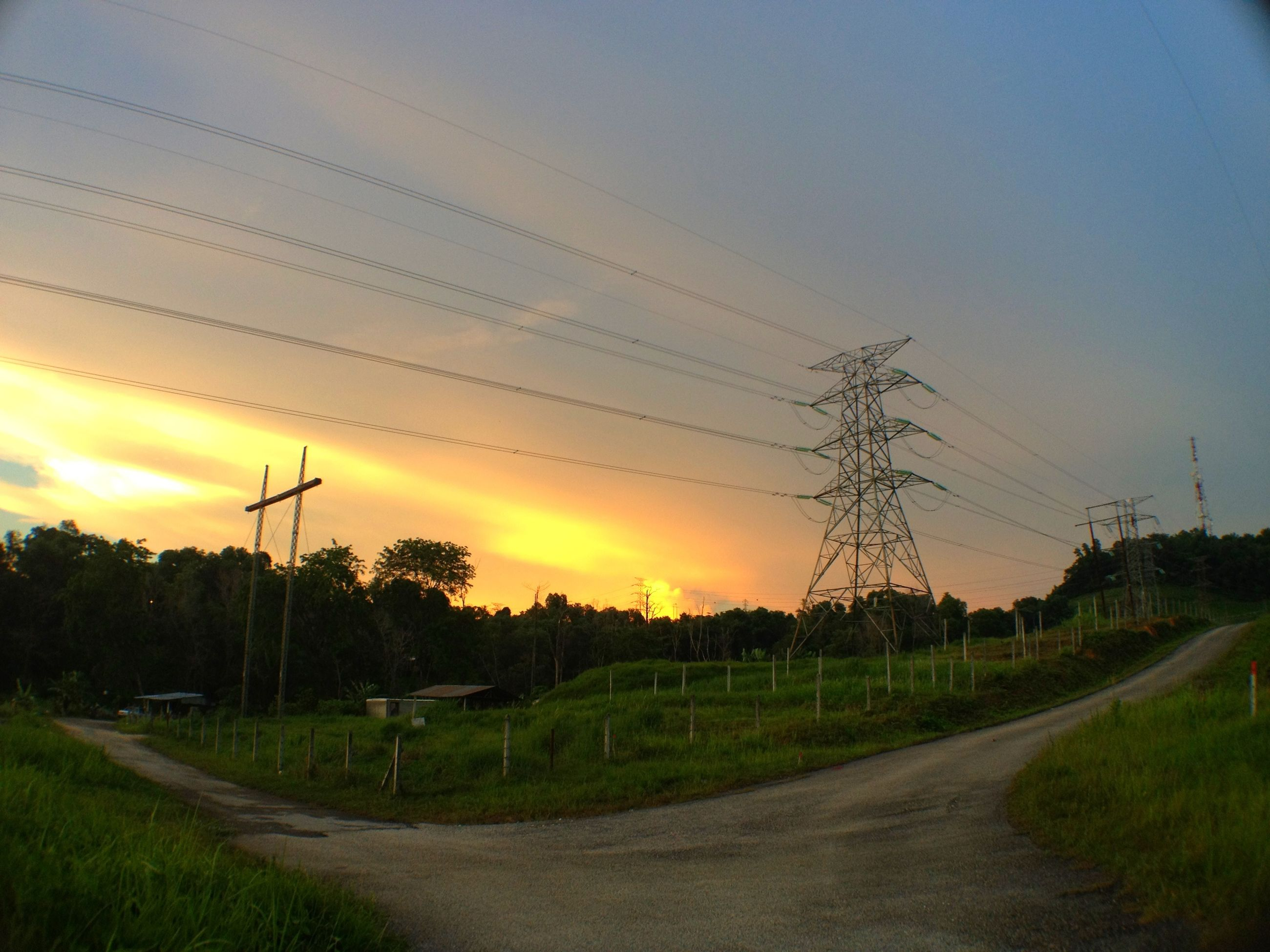 electricity pylon, sunset, power line, fuel and power generation, electricity, landscape, field, power supply, rural scene, sky, road, tranquil scene, tranquility, the way forward, tree, scenics, connection, orange color, nature, transportation